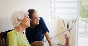 Generations Gap Happy Old Woman And Granddaughter Taking Selfie stock photography