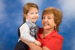 Generations: grandmother with her grandson. Portrait of grandmother holding two year old boy smiling and happy Stock Photo