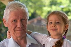 Generations - grandpa and girl Stock Image
