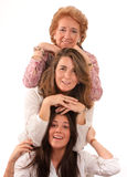 Generations of women. Portrait of Three generations of women of the same family isolated in white Royalty Free Stock Photos