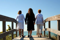 Generations of women boardwalk royalty free stock photography