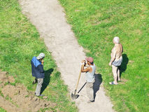 Generations. Young workers and sunbathing oldman in city lawn. Moscow, Russia, 2013 Royalty Free Stock Photography