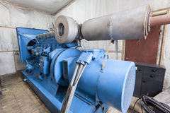 Generator. Huge generator in a modern factory interior Royalty Free Stock Photography