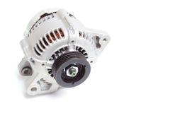 Generatore del motore di automobile su un fondo bianco Immagini Stock