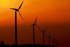 Generatore eolico con il tramonto Fotografia Stock