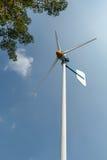 Generatore eolico verde di energia nel funzionamento Fotografia Stock