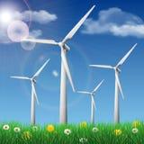 Generatori eolici su un campo di erba Immagini Stock