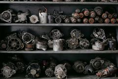 Generators and starters are stacked on the shelf royalty free stock images