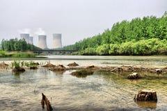 Generazione e danno ambientale di energia Fotografie Stock