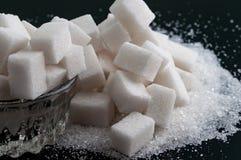Genere due di zucchero sulla superficie del nero Fotografia Stock Libera da Diritti