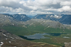 Genere sul lago della montagna Fotografia Stock