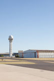 Generic airfield with hangar and control tower stock photos