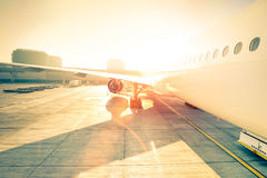 Generic airplane on terminal gate ready for takeoff at airport Stock Photos
