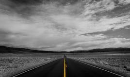 Generic Desert Scene. Generic arid desert scene together with cumulus clouds above stock photo