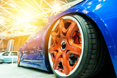 Generic blue sport car with orange wheel Royalty Free Stock Photo