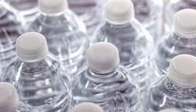 Generic Bottled Water. Bottled water with bright white light in the background. Generic, with no labels royalty free stock images