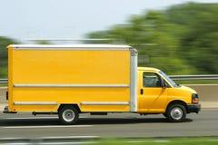 Generic Bright Yellow Van/Truck. A bright yellow truck van speeds down the highway. Copy space on side of van Stock Photos