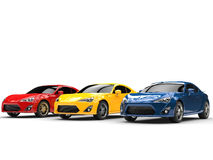 Generic cars - red, yellow and blue colors Royalty Free Stock Images