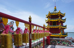 Generic Chinese layer pagoda with golden bell forground Stock Photo