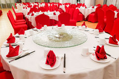 Generic Chinese wedding dinner banquet set-up with dinnerwares. Typical generic Chinese wedding dinner banquet set-up with dinnerware arranged Stock Images