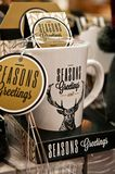 Season greetings mugs closeup, Christmas merchandise Royalty Free Stock Photos