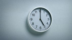 5 O`Clock - Wall Clock Moving Shot. Generic clock on wall showing 5 o`clock tracking shot stock footage
