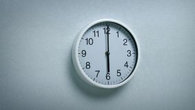 6 O`Clock - Wall Clock Moving Shot. Generic clock on wall showing 6 o`clock tracking shot stock video footage