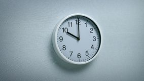 10 O`Clock - Wall Clock Moving Shot. Generic clock on wall showing 10 o`clock tracking shot stock footage