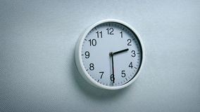 2.30 clock on wall. Generic clock on wall showing 2.30 tracking shot stock footage