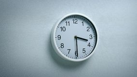 3.30 clock on wall. Generic clock on wall showing 3.30 tracking shot stock footage