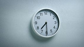 7.30 Clock On Wall. Generic clock on wall showing 7.30 tracking shot stock footage