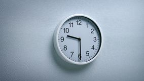 9.30 Clock On Wall. Generic clock on wall showing 9.30 tracking shot stock footage