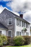 Generic colonial architecture in New England. Generic colonial architecture house in Sandwich Massachusetts on a sunny day in New England royalty free stock photo