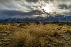 Generic Desert Scene. Generic arid desert scene together with cumulus clouds above royalty free stock images