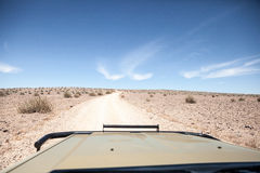 Generic desert scene viewed from 4x4 Royalty Free Stock Photos