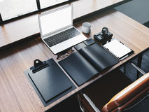 Generic design laptop on the wooden table with Stock Photo