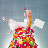 Generic Doll Bride and Candy Pile Royalty Free Stock Photography