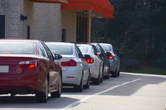 Free Generic Drive Thru Pickup Window With Cars Waiting In Line To Get Their Products Or Food Royalty Free Stock Photos - 168077388