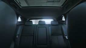 Generic empty car interior. Low angle track forward shot stock footage