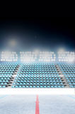 Generic Floodlit Stadium. An ice hockey stadium with a marked ice rink at night under illuminated floodlights royalty free stock photography