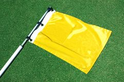 Generic golf flag. Golf flag lying on a putting green royalty free stock images