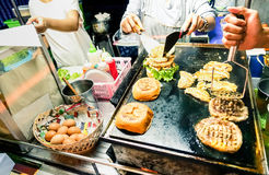Generic hamburger vendors cooking beef and chicken burgers Royalty Free Stock Photography