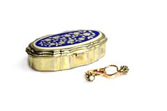 Generic Jewelry on White. Generic Antique Jewelry - Gold Earrings and Gilded Case on white Stock Images