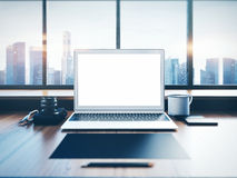 Generic laptop on the workspace with panoramic Royalty Free Stock Image