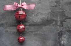 Generic machine made Christmas bells ornament on rustic style ba Royalty Free Stock Image