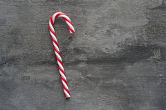 Generic machine made Christmas candy cane ornament on rustic sty Royalty Free Stock Images