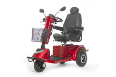 Generic mobility scooter for disabled or elderly people against. Generic electric mobility scooter for disabled or elderly people against white background in royalty free stock image