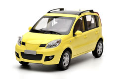 Generic modern yellow family car model Royalty Free Stock Images