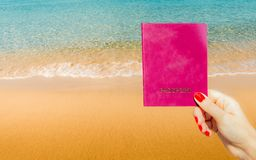 Generic passport with idyllic tropical beach background. Generic passport with idyllic tropical beach golden sand on background Stock Photography