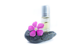 Generic Perfume and Purple Flower on stone, white background Stock Image